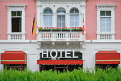 Cosy and romantic hotel. Detail of a cosy and romantic hotel facade stock image