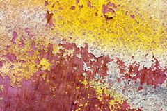 Detail of crack old wall color paint red yellow Royalty Free Stock Photo