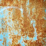 Detail of cracked paint on rusty metal wall. Royalty Free Stock Photo