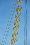Detail crane jib against a blue sky Stock Images