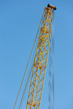 Detail crane jib against a blue sky Stock Photos