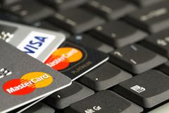 Detail of credit cards on top of a laptop keyboard macro photo. Royalty Free Stock Photo