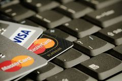 Detail of credit cards on top of a laptop keyboard macro photo. Royalty Free Stock Photography