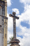 Detail of a cross from an ancient church in Olinda, Recife, Brazil. With blue sky at the background stock images
