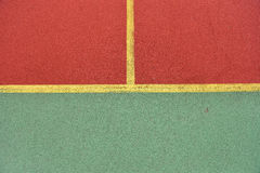 Detail of crossed yellow lines on football playground. Detail of Royalty Free Stock Photos