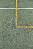 Detail of crossed yellow and white lines on football playground. Stock Photo