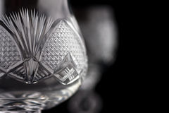 Detail of crystal cut glass. On black background royalty free stock images
