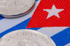 Detail of Cuban coin and flag Royalty Free Stock Photos