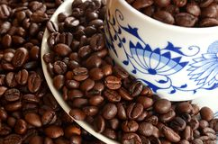 Detail of cup of coffee and pile of coffee beans Royalty Free Stock Image