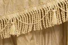 Detail of curtains with fringe and tassels Stock Photography