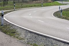 New asphalt road with curves and bump stock photos
