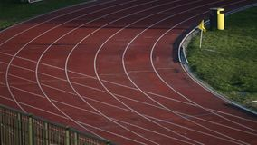 Detail of a curve in a running track stock video footage