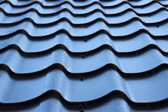 Detail of curved black metal roof Stock Images