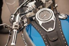 Detail of a custom motorbike. Focus on the speedometer. Vintage motorcycle detail stock image
