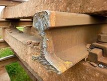 Detail of cut rail. Autogen torch  cut rail rod on concrete sleeper. Repair of tramway. Royalty Free Stock Photo