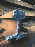 Detail of cut rail. Autogen torch  cut rail rod on concrete sleeper. Repair of tramway. Royalty Free Stock Images