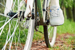 Detail of cyclist man feet riding bike Royalty Free Stock Photography