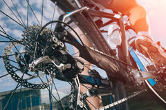 Detail of cyclist man feet riding mountain bike Royalty Free Stock Image