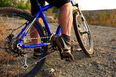 Detail of cyclist man feet riding mountain bike on outdoor Stock Photography
