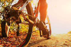 Detail of cyclist man feet riding mountain bike on outdoor Stock Image