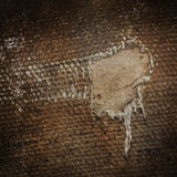Detail (damage) of an old canvas suitcase, close-up Royalty Free Stock Photos