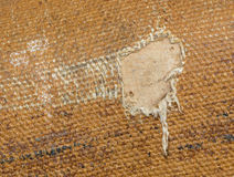 Detail (damage) of an old canvas suitcase, close-up Royalty Free Stock Photography
