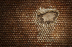 Detail (damage) of an old canvas suitcase, close-up Stock Photos