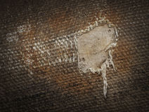 Detail (damage) of an old canvas suitcase, close-up Stock Photography
