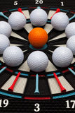 Detail dartboard with golf balls Stock Photography
