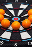 Detail dartboard with golf balls Stock Image