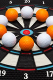 Detail dartboard with golf balls Royalty Free Stock Photos