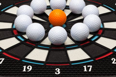 Detail dartboard with golf balls Royalty Free Stock Photography
