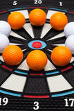 Detail dartboard with golf balls Royalty Free Stock Photo