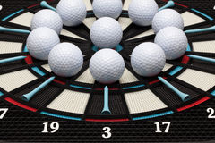Detail dartboard with golf balls Stock Photos