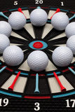 Detail dartboard with golf balls Stock Photo
