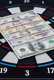 Detail dartboard with US dollars Royalty Free Stock Photography