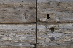 Detail of decaying wooden door. With keyhole, nails and texture of rotten wood with wormholes royalty free stock photos