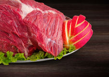 Detail of decorated fresh raw meat - ham with vegetables  Royalty Free Stock Photos