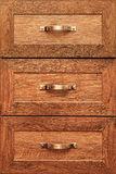 Detail of decorated furniture drawers. Old drawer - damper. Close-up detail of high quality Oak wood cabinets with bronze cabinet hardware drawer pulls Stock Photo