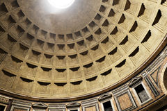 Detail of decorated unreinforced concrete Dome of the Pantheon, Rome, Italy with central opening (oculus) Stock Images