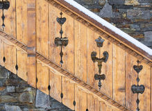 Detail of decorative balustrade on mountain chalet in snow Stock Images