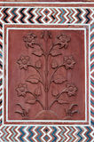 Detail decorative of the Jawab. Taj Mahal. Detail decorative of the Jawab. Patterns in red sand stone with inlaid marble. Taj Mahal. Agra. India Royalty Free Stock Images