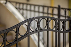 Detail of decorative metal fence. Detail of metal fence made ​​of wrought iron with floral Stock Photography
