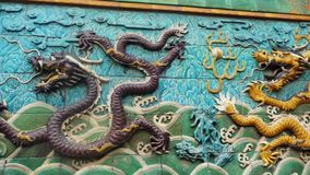 Detail of decorative Nine dragon Wall in the Forbidden City, Beijing, China, slow motion