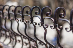 Detail of decorative wrought iron. Detail of metal fence and gate house made ​​of wrought iron Royalty Free Stock Image