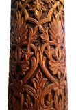 Detail of a Decoratively Hand-carved Pillar. An isolated macro closeup image of a decorative pillar carved with natural lace like designs of leaves, flowers, and Stock Image