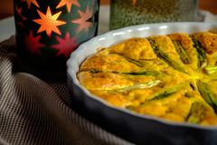 Detail of delicious quiche made with eggs and asparagus royalty free stock image