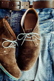 Detail of denim jeans and leather shoes Royalty Free Stock Photos