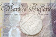Detail der Banknote und zehn Pennys Stockbild