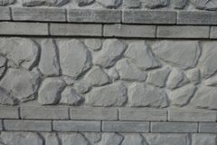 Detail der Betonmauer mit Stein mögen Muster Stockfotografie